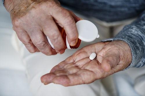 man taking a supplement pill